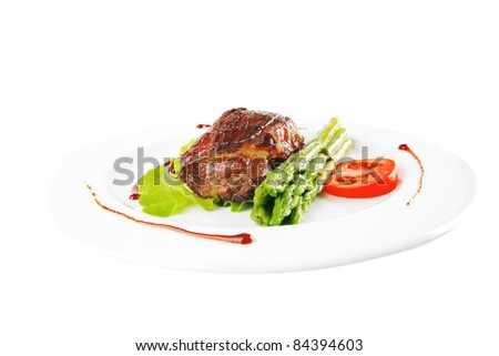 served roasted beef meat with asparagus on white dish - stock photo
