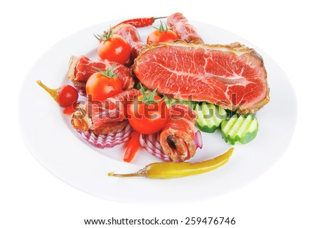 served roasted meat chunk with rolls on white platter - stock photo