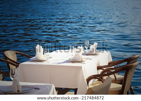 served scenic cafe table near the sea
