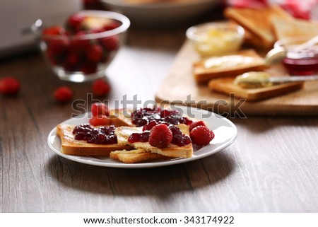 Served table for breakfast with toast and jam, close-up - stock photo