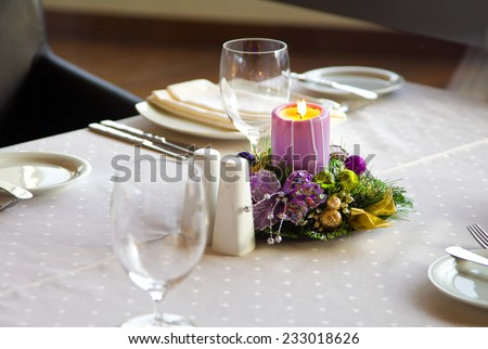 served table in a restaurant decorated for Christmas - stock photo