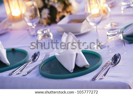 Served table in outdoor restaurant. Shallow depth of field. - stock photo