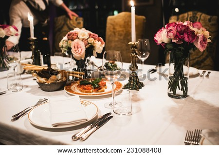 [fb] les angélus // jola&monsiame Stock-photo-served-table-set-with-flowers-and-empty-wine-glasses-in-french-restaurant-231088408