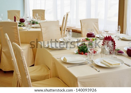 Served table with appetizers, dishes and glasses. - stock photo