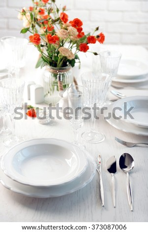 Served table with flowers in restaurant, closeup - stock photo