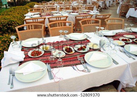 served tables in outdoor restaurant in exclusive hotel, Turkey - stock photo