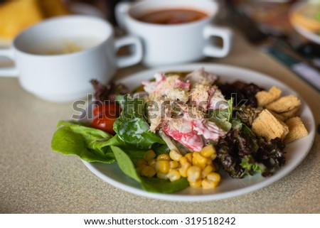 Served with a salad bar vegetables Morning Buffet - stock photo