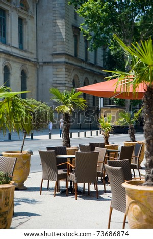Served with dining tables in the outdoor cafe - stock photo