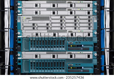 Server computer and Digital media manager install on rack in datacenter room. - stock photo