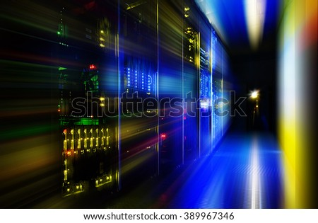 server room in dark, with bright colored lights motion - stock photo