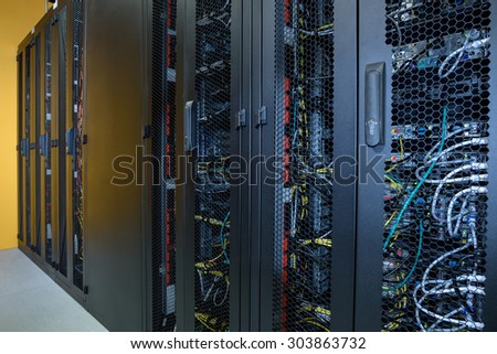 Server room with racks of internet computers - stock photo