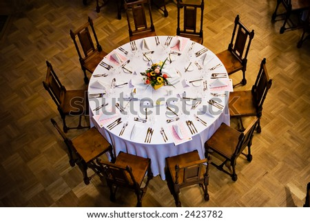 Server round table with chairs - stock photo