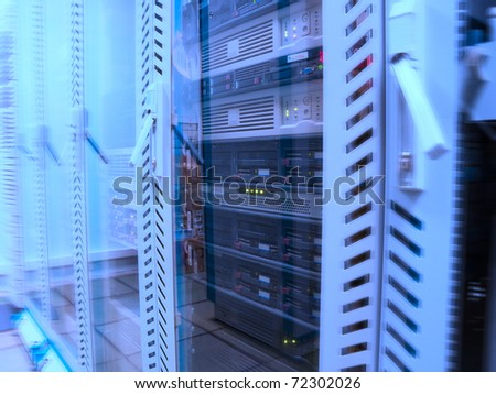 Servers in the data center in blue - stock photo