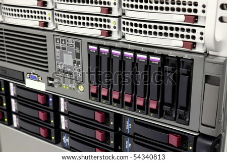 servers stack with hard drives in a datacenter for backup and data storage - stock photo