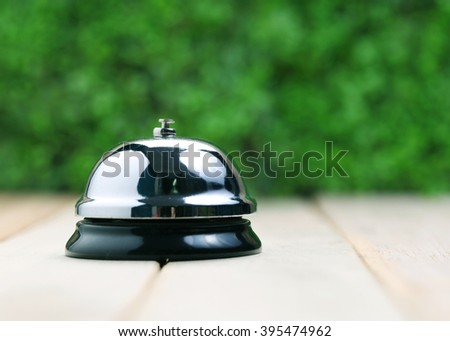 Service bell on a wooden table