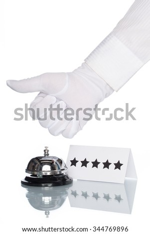 Service bell on the Check in desk with white background, star shap