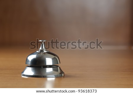 service bell on the hotel reception desk with copy space - stock photo