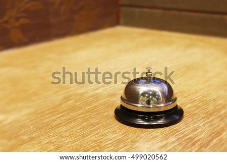 Service bell on the wooden table