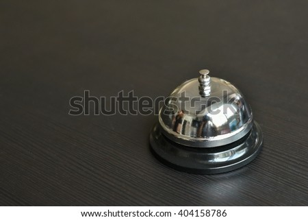service bell on wooden table. - stock photo