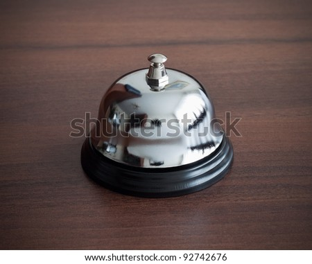 Service bell ring on wooden background - stock photo