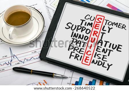 service crossword concept handwritten on tablet pc - stock photo