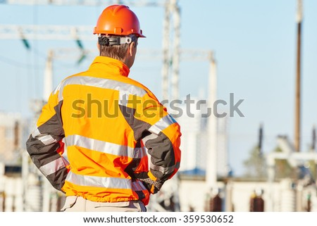 Service engineer standing at heat electropower station - stock photo