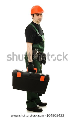 Service man wearing helmet and overall holding black toolbox over white - stock photo