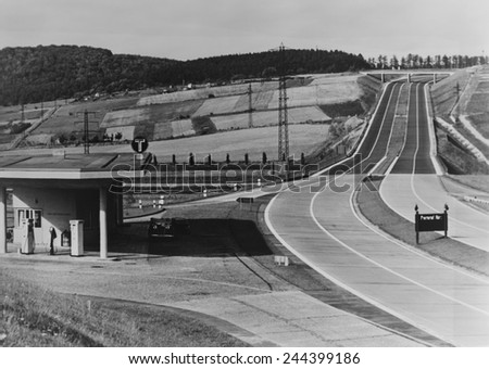 Service Station of the German Autobahn a four lane divided highway with entrance and exit ramps. Ca. 1938.
