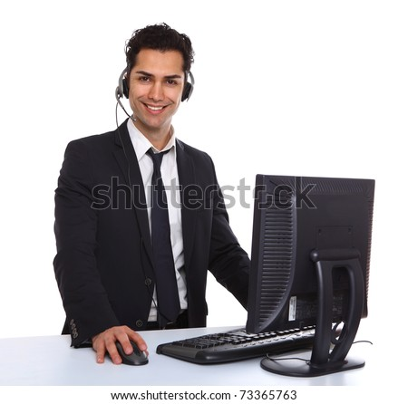 Service with a smile  male secretary near a computer - stock photo