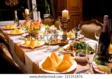 service with silverware and glass stemware for an event party - stock photo