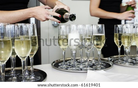 serving champagne at a party - stock photo