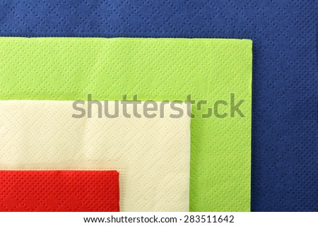 Serving colored paper napkins closeup - stock photo