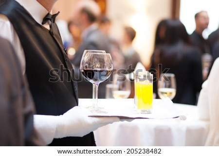 serving drinks at a party - stock photo