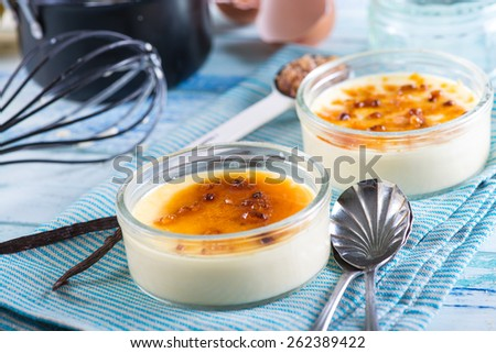 serving homemade creme brulee - stock photo