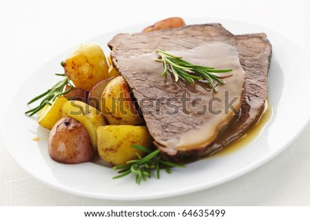 Serving of roast beef and roasted potatoes meal