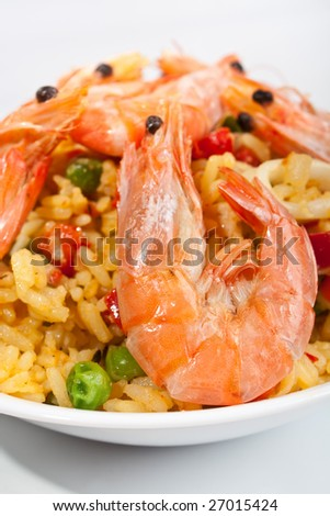 serving of spanish paella on white background - stock photo