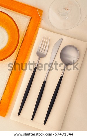Serving set with orange plate and martini glass - stock photo