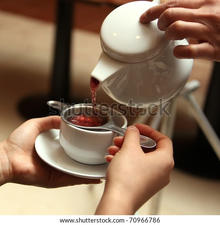 serving tea in a china teapot - stock photo