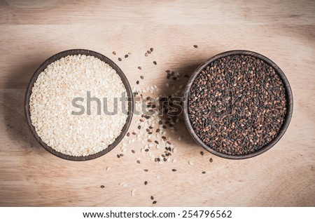 sesame and poppy in wood bowl - stock photo