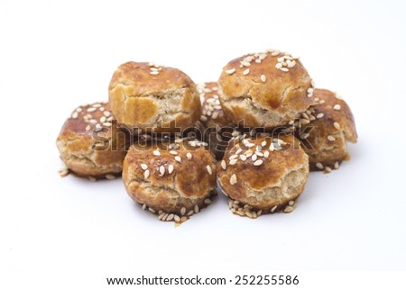 sesame coated peanut biscuits on white background - stock photo