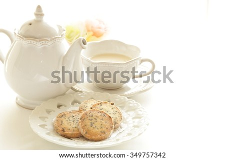 Sesame cookie and tea - stock photo