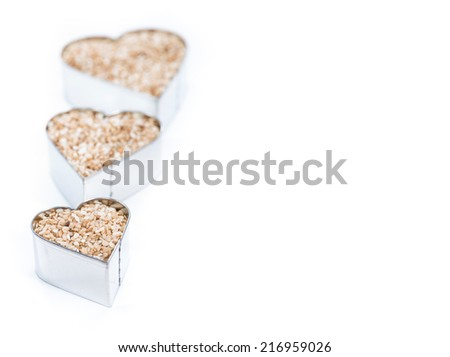 Sesame Hearts isolated on white background (with copyspace) - stock photo