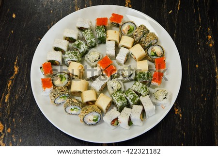 sesame, japanese, food, sushi, dish, meal, avocado, roll, dinner, caviar, raw, tasty, lunch, seaweed, eating, cuisine, rice, asian, appetizer, fresh, chopsticks, fish, traditional, restaurant,  - stock photo