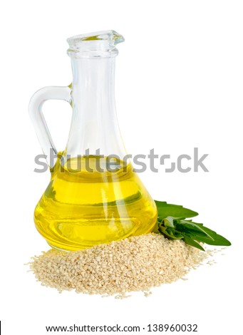 Sesame oil oil in a glass jug. - stock photo