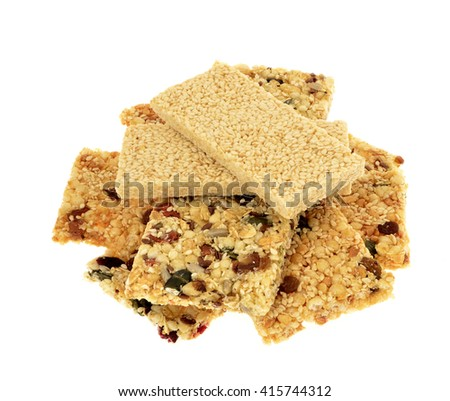Sesame seed , and nut energy bar, white background.