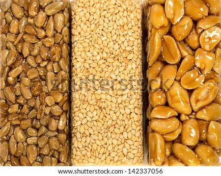 Sesame Seed Brittle - kozinaki, candied roasted sunflower���´s seeds, peanuts and til in icing sugar caramel - stock photo