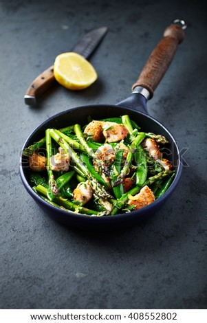 Sesame Seed Chicken with Green Asparagus and Sweet Peas - stock photo