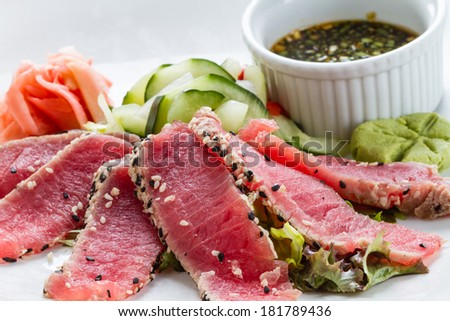 Sesame Seed Crusted Seared Tuna served with vegetables and sauce. - stock photo