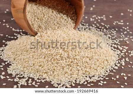 Sesame seeds in a wooden bowl - stock photo