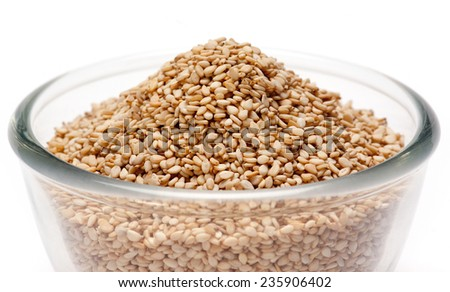 Sesame Seeds in bowl isolated on white background - stock photo